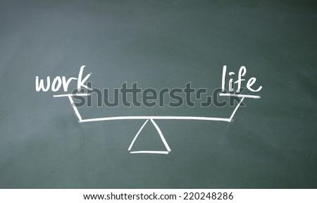 work and life balance sign on blackboard - stock photo
