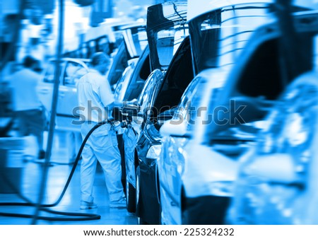 work at big car factory industry - stock photo
