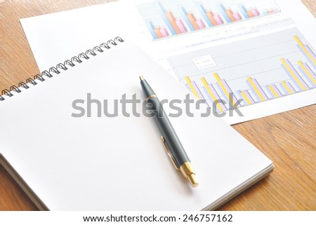 work book and chart  - stock photo