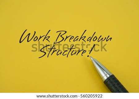 Work Breakdown Structure (WBS)! note with pen on yellow background