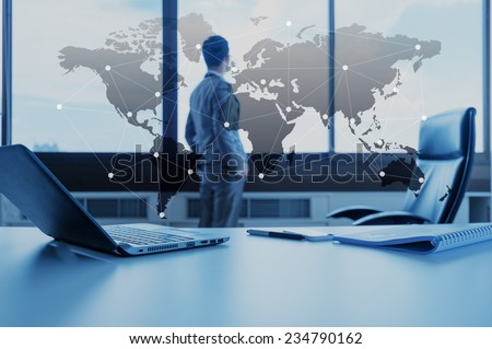 work desk of businessman with laptop, globalization business concept - stock photo