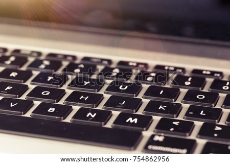 Work for the laptop. laptop keyboard close-up