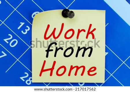 Work From Home message on a note paper - stock photo