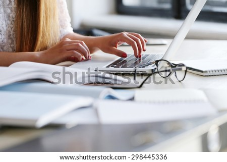 Work. Girl in the office - stock photo