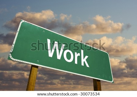 Work Green Road Sign with dramatic clouds and sky. - stock photo