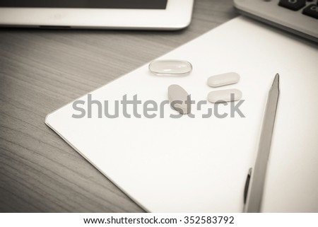 work hard concept - work desk with supplements, monochrome - stock photo