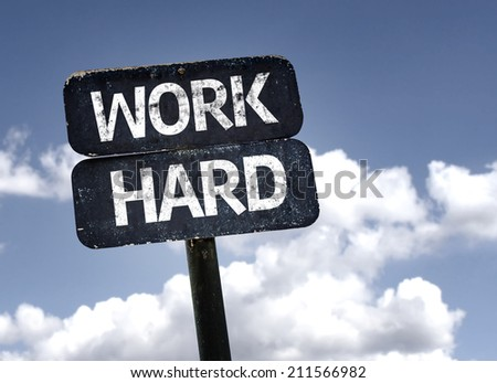 Work Hard sign with clouds and sky background  - stock photo