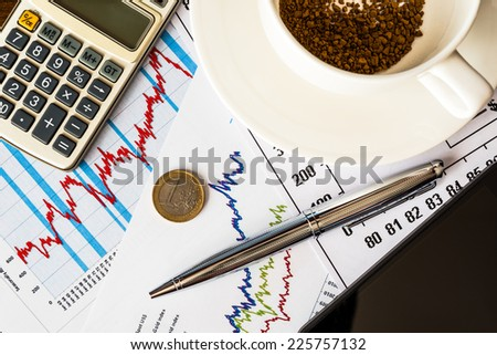 Work in exchange, coffee cup with calculator and cell phone - stock photo