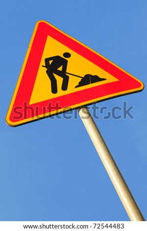 Work in progress road sign on a deep blue sky