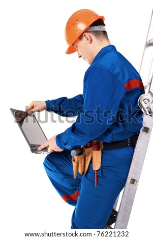 Work man in work-wear with instrument in studio against white background - stock photo