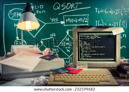 Work on algorithm in the vintage computer lab - stock photo