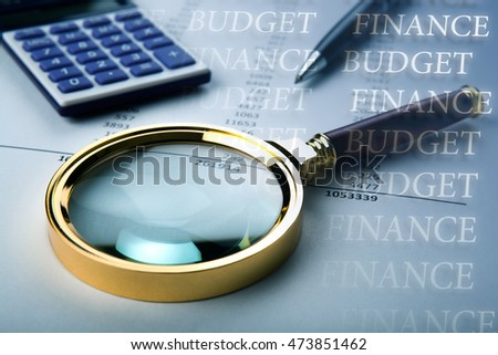 work on the budget with a magnifying glass, a calculator