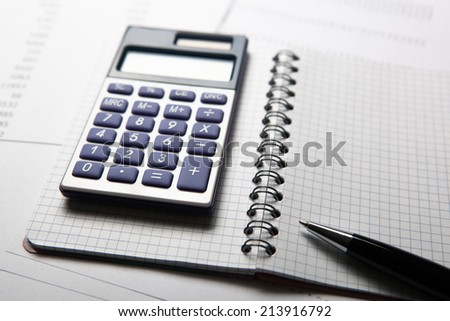 work on the calculator and papers close up