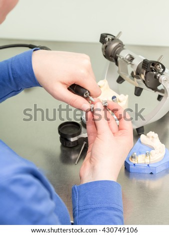 work on tooth crown in dental laboratory