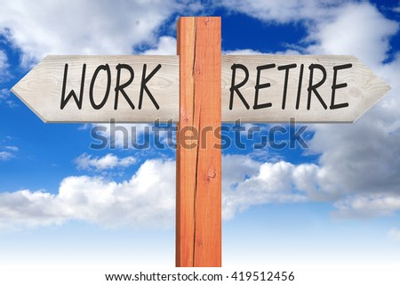 Work or retire - wooden signpost - stock photo