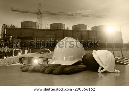 work outdoor wear safety equipment  at utility construction site sepia tone. - stock photo