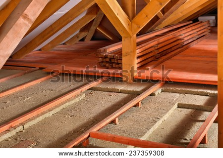 Work site installing thermal insulation using stock photo for Mineral wool installation