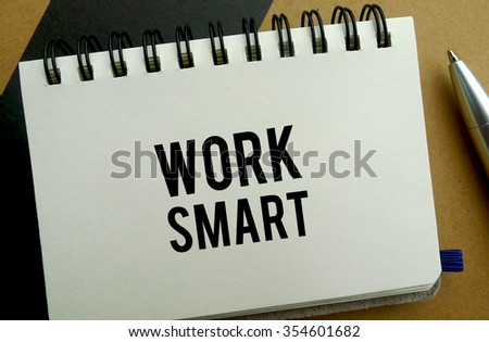 Work smart memo written on a notebook with pen - stock photo