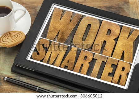 work smarter-advice  wood type text on a digital tablet with a cup of coffee - stock photo