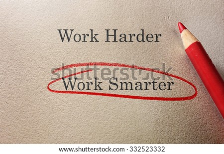 Work Smarter circled in red pencil with Work Harder text - stock photo