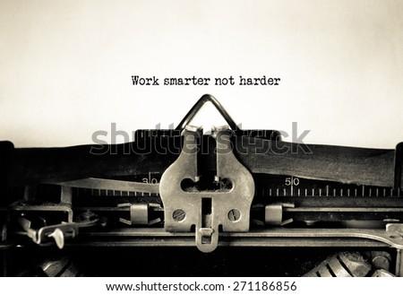 Work Smarter not Harder message typed on vintage typewriter  - stock photo