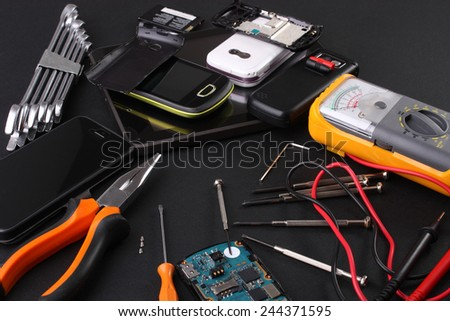 Work table repairing mobile phones stock photo 244371595 shutterstock work table for repairing mobile phones greentooth Image collections
