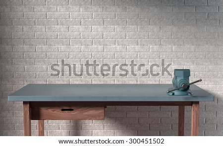 work table of a carpenter on white brick wall background - stock photo