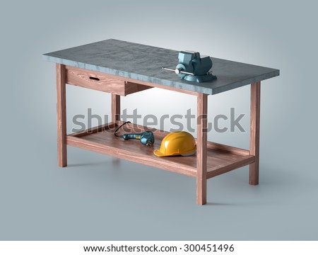 work table of a carpenter with vise, helmet and drill - stock photo
