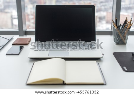 Work table, workplace with notebook laptop close up - stock photo