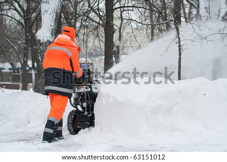 Work the removal snow with snow machines - stock photo