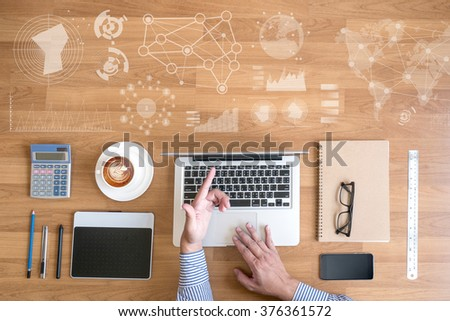 work with financial reports and a laptop with other objects around, coffee,  top view, with digital layer business strategy and social media diagram on wooden desk - stock photo