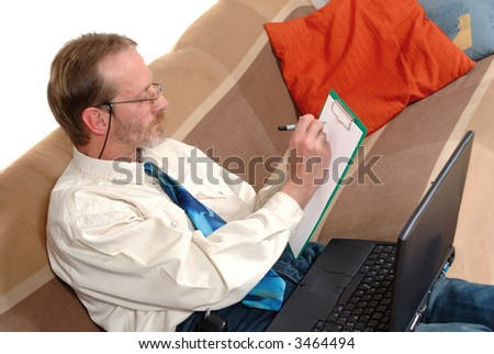 Workaholic, attractive middle aged  businessman working on  laptop at home. Business, corporate, overtime concept.