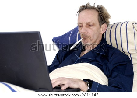 Workaholic, sick in bed working on laptop, thermometer on mouth, feverish. Business, stress, health care concept.