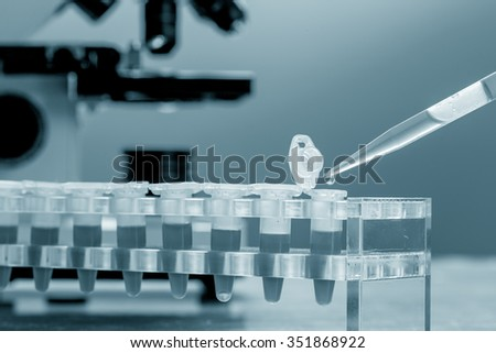 Workbench blood bank laboratory with a microscope and tubes with patient samples