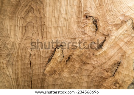 Worked wood with a distinctive structure and pattern. - stock photo
