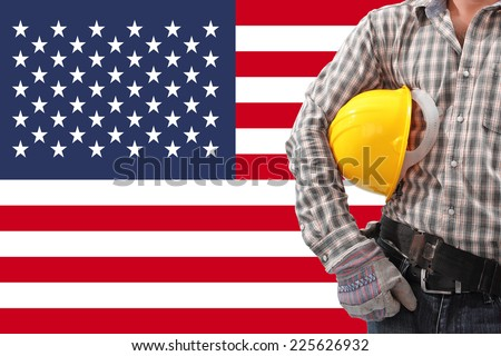 Worker and usa flag for working on labor day - stock photo