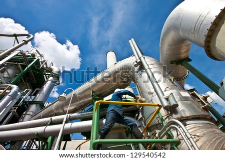 worker are closed flang of pipe. - stock photo