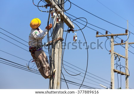 worker are installing electricity poles. - stock photo