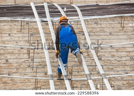 worker at construction site - stock photo