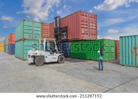 worker check information container box with forklift handling at dockyard - stock photo