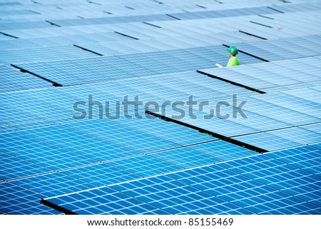 worker check solar power station top view - stock photo