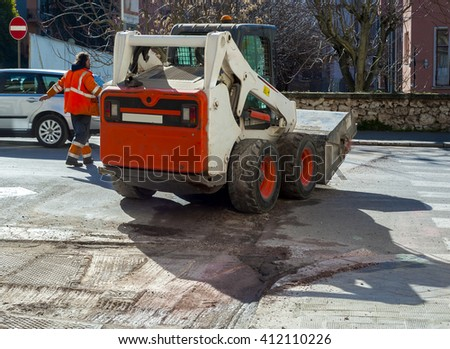 Worker checks traffic during the road surface milling work - stock photo