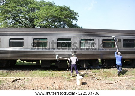 Worker cleaning the train at station Thailand. - stock photo