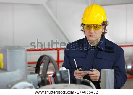 Worker controls devices in a power plant