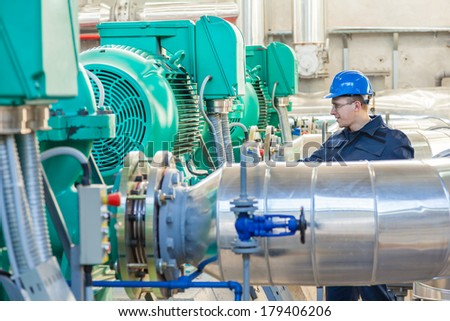 Worker controls quality of work in the factory hall - stock photo