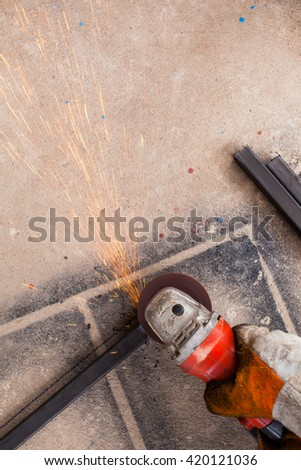 Worker cutting iron  with grinder