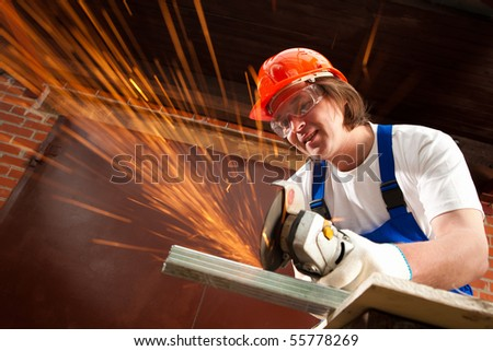 worker cutting metal