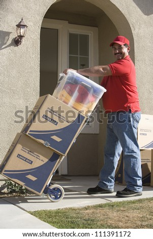 Worker delivering cardboard boxes - stock photo