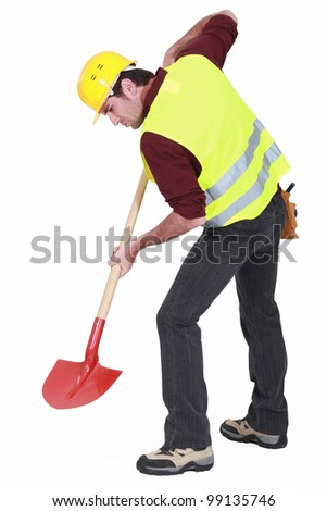 Worker digging with a shovel - stock photo
