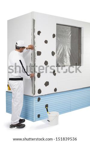 Worker fixing a corner-lath - stock photo
